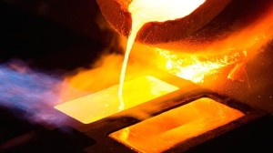 Molten-gold-pours-from-a-crucible-into-a-heated-mold-after-refining-at-the-Kaloti-Jewellery-LLC-factory-in-Sharjah-United-Arab-Emirates.