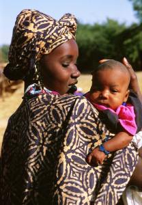 Portrait of an African mother holding her new baby. Mali.